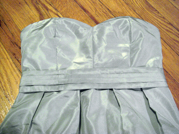 Here the waist band has been pressed and attached to the dress