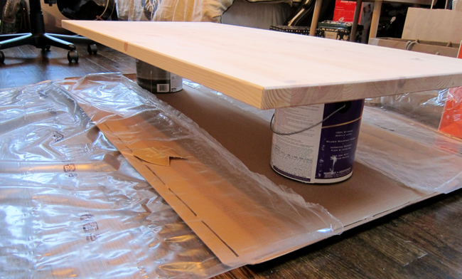 I Propped The Table Top On Two Old Paint Cans And Used Ikea Packaging As A Drop Cloth Then Lightly Sanded Surface