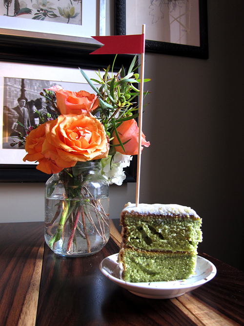 Orange peach roses with green tea cake and flag