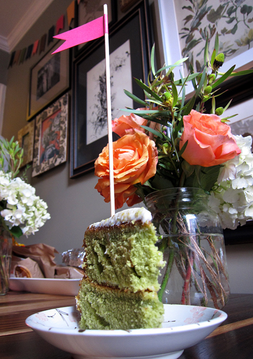 orange peach roses and green tea cake with flag
