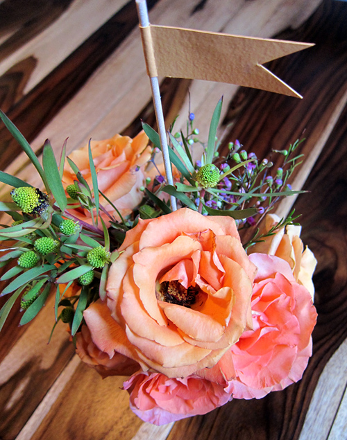 from the field orange peach rose flower arrangement with flag