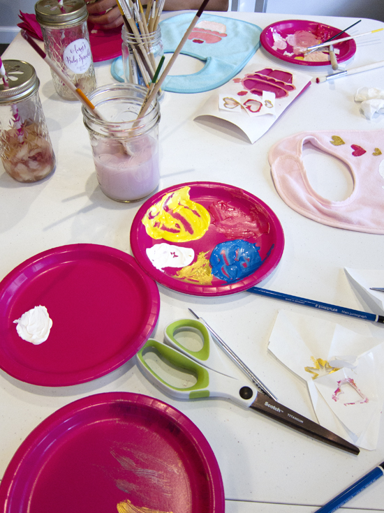 A Magenta and Gold Baby Shower - Bib decorating station - >> joeandcheryl.com <<